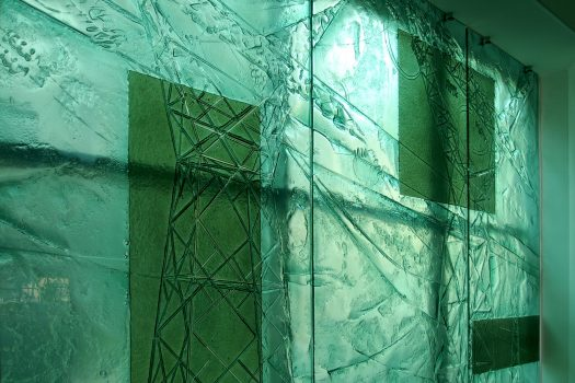 Green glass wall with electricity theme by Urbanowicz